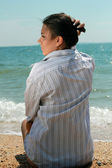 Relaxing young woman on a beach — Stock Photo