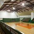 Interior of a modern multifunctional gymnasium with young — Stock Photo #6148446