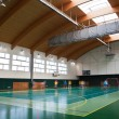 Interior of a modern multifunctional gymnasium with young — Stock Photo #6148449