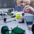 Female scientist doing research in a quantum optics lab (color t — Stock Photo