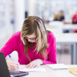 In the library - pretty, female student with laptop and books wo — Stock Photo #6148479