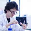 Young male researcher carrying out scientific research in a chem — Stock Photo