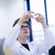 Young male researcher carrying out scientific research in a chem — Stock Photo #6148561
