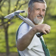 Portrait of a senior man gardening in his garden — Stock Photo #6148628