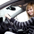Pretty young woman driving her new car (shallow DOF; color toned — Stock Photo #6148713