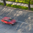 Speeding concept - Cars moving fast on a road on a lovely sunny — Foto de Stock