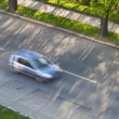 Royalty-Free Stock Photo: Speeding concept - Cars moving fast on a road on a lovely sunny