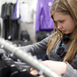 Stock Photo: Pretty teenager shopping for clothes in boutique/fashion shop/