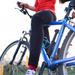Pretty young female biker outdoors on her mountain bike (shallow — Stock Photo