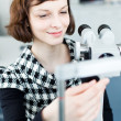 Optometry concept - portrait of a young pretty optometrist using — Stock Photo