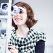 Optometry concept - portrait of young pretty optometrist using — Stockfoto #6148911