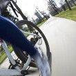 Bicycle riding in a city park on a lovely autumn/fall day (motio — Stock Photo