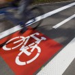 Urban traffic concept - bike/cycling lane sign in a city — Stock Photo