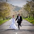 Young wedding couple - freshly wed groom and bride posing outdoo - Stock Photo