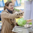 Beautiful young woman shopping for fruits and vegetables in prod — Stock Photo #6149322