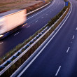 Highway traffic - motion blurred truck on a highway/motorway/spe — Stock Photo