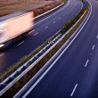 Highway traffic - motion blurred truck on a highway/motorway/spe — Foto de Stock   #6149357