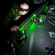 Stock Photo: Female scientist doing research in quantum optics lab