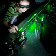 Female scientist doing research in a quantum optics lab — Stock Photo #6149395