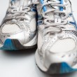 Pair of running shoes on a white background (shallow DOF; color — Stock Photo #6149406