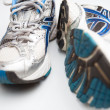 Pair of running shoes on a white background (shallow DOF; color — Stock Photo #6149408