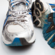 Pair of running shoes on a white background (shallow DOF; color — Foto Stock