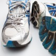 Pair of running shoes on a white background (shallow DOF; color — ストック写真