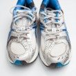 Pair of running shoes on a white background (shallow DOF; color — 图库照片
