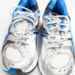 Royalty-Free Stock Photo: Pair of running shoes on a white background (shallow DOF; color