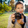 Pretty female photographer outdoors on a lovely day — Stock Photo #6149434