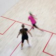 Two female squash players in fast action on a squash court (moti — Stock Photo #6149675