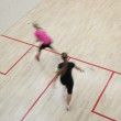 Two female squash players in fast action on a squash court (moti — Stock Photo #6149677