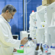 Senior male researcher carrying out scientific research in a lab — Stock Photo #6149801