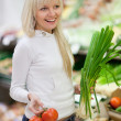Beautiful young woman shopping for fruits and vegetables in prod — Stock Photo #6149907