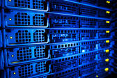 Server rack cluster in a data center (shallow DOF; color toned i — Photo