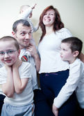 Beautiful young happy family standing together (shallow DOF - sh — Stock Photo