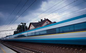 Fast train passing by (motion blur is used to convey movement; c — Stock Photo
