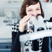 Optometry concept - portrait of a young pretty optometrist using — Stockfoto