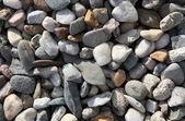 Background texture with round pebble stones — Stock Photo
