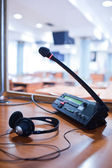 Interpreting - Microphone and switchboard in an simultaneous int — Stock Photo