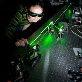 Female scientist doing research in a quantum optics lab — Stock Photo