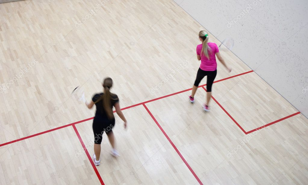 Two female squash players in fast action on a squash court (motion blurred image; color toned image) — Stock Photo #6149662