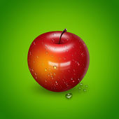 červené jablko kapkami vody — Stock fotografie