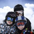 Mother with two boys skiing - Stock Photo