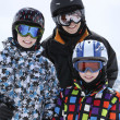 Mother with two boys skiing — Stock Photo #5449499