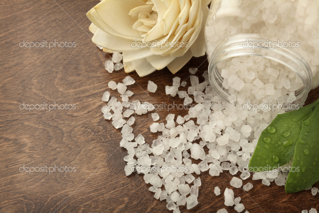 Closeup of bath salt spiled on a wooden surface — Stock Photo #5587743