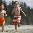 Boys running at a beach — Stock Photo