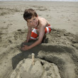 Stock Photo: Building sandcastle