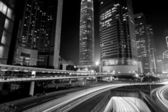 Traffic through downtown in Hong Kong at night — Stock Photo