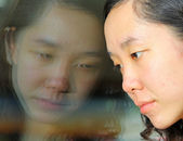 Asian girl with sad face — Stock Photo